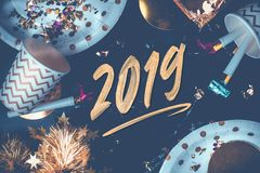 2019 new year hand brush storke font on marble table with party stock images