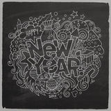 New year hand lettering and doodles chalk board Stock Image
