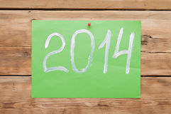 2014 new year. Hand writing text  2014 new year on wooden wall. The symbol of the new year Royalty Free Stock Photos