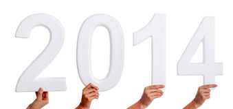 New year 2014. Hands holding numbers of new year 2014 Royalty Free Stock Photography