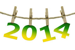New year 2014, hanging on the clothesline on  white background.  Royalty Free Stock Photo