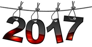 New Year 2017 - Hanging on Steel Cable. Happy New Year 2017, black and red numbers hanging from a steel cable and isolated on a white background Royalty Free Stock Images
