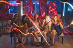New 2018 Year. Happy girls company. Christmas celebration party, female friends in night club. Pleasant leisure time, friendship concept Stock Image