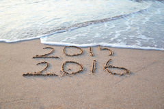 New year. Happy New Year 2016 replace 2015 concept on the sea beach Royalty Free Stock Photo