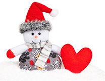 New Year 2016. Happy Snowman on snow with heart Stock Photos