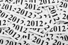 New Year 2012. Heap of pieces of paper with the number 2012. Black and White. Close-up Stock Photos