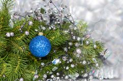 New year holiday. Decorative ball on the background of fir royalty free stock images