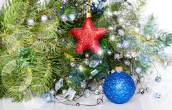 New year holiday. Decorative ball and staron the background of fir royalty free stock photo
