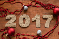 2017 New Year holiday background. On the brown wooden table Royalty Free Stock Photos