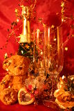 New year holiday card. Close-up of glasses, champagne bottle and bear toy Stock Photography