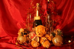 New year holiday card. Holiday card: Close-up of glasses, champagne bottle and bear toy Stock Images