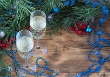 New Year holiday composition, champaign, pine, ornament decoration. Christmas and New Year still life composition with two champaign glasses, pine tree acerose stock photos