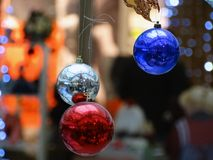 New year holiday - the most magical day of the year. Three colorful shiny balls reflects the holiday rush at the Mall Stock Photos