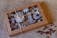 Free New Year Holiday Set Of Honey Cookies Stylized As Wooden Numbers 2, 0, 1, 8, White Stars Laying In Paper Box On Brown Sackcloth Ba Stock Photos - 104363613
