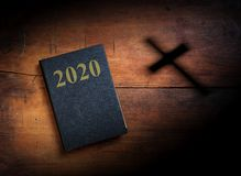 2020 New year. Holy Bible with 2020 text on wooden background. 3d illustration royalty free stock photos