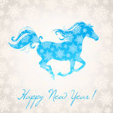 New year horse and snowflakes. New year card with a symbol of the coming year - the horse and beautiful snowflakes Royalty Free Stock Photos