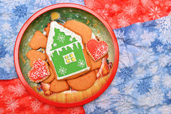 New year house and hearts cookies in dish. Flat. Horizontal. Free space. Cookies on red and blue background Stock Photography