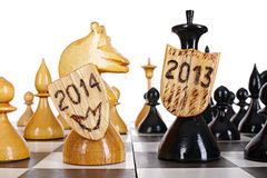 New Year idea. Chess battlefield between 2013 and 2014 years Stock Image