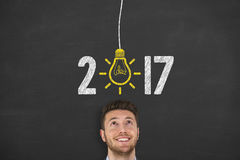 New Year 2017 Idea Concept on Blackboard Background Stock Images