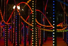 New year illumination in the night city. Background: colorful lights - a fragment of New Year`s illumination outdoors in the night city stock image