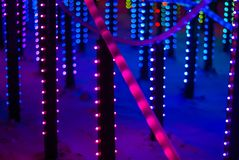 New year illumination in the night city. Background: colorful lights - a fragment of New Year`s illumination outdoors in the night city stock photography