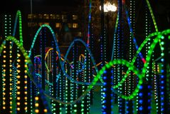 New year illumination in the night city. Background: colorful lights - a fragment of New Year`s illumination outdoors in the night city royalty free stock images