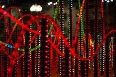 New year illumination in the night city. Background: colorful lights - a fragment of New Year`s illumination outdoors in the night city royalty free stock photo