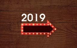 New Year illustration design. White& x22;2019& x22; on wooden-shaped backround.Under the number is a horizontal shine golden sign royalty free illustration