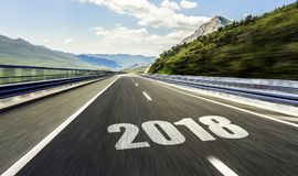 Empty asphalt road and New year 2018. stock photos