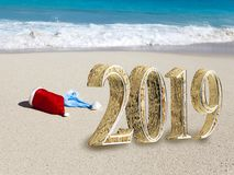 New Year inscription 2019 on the beach stock photos