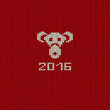 New Year Knitted Pattern Card with Monkey Face. Knitted pattern card with funny monkey face. Chinese zodiac symbol of New Year 2016 Stock Images