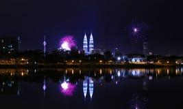 New Year at Kuala Lumpur Malaysia. KUALA LUMPUR, MALAYSIA - JAN 1: A reflection of fireworks during the New Year 2011 celebrations near Malaysia landmark Royalty Free Stock Image