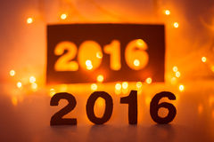 New Year 2016, lights,  figures made of cardboard Stock Photography