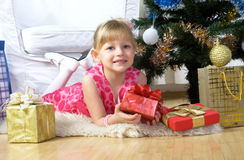 Before New Year. Little girl in a smart dress near the Christmas Tree Stock Photography