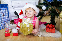 Before New Year. Little girl in a smart dress near the Christmas Tree Stock Images
