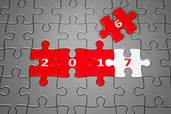 New Year 2017 made from puzzles. New Year 2017 made from red and white puzzle pieces, 3d rendering, 3D illustration Royalty Free Stock Photo
