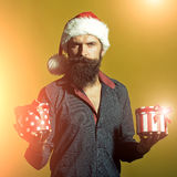 New year man with presents Stock Photos