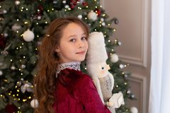 Free New Year. Merry Christmas, Happy Holidays. A Close-up Portrait Of Face Of A Girl Holding A Nutcracker Toy In Her Hands In Front Of Royalty Free Stock Photo - 167093925