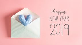 New Year message with a blue heart cushion. In an envelope stock photography