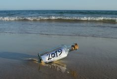New Year 2019, message in a bottle stock photo