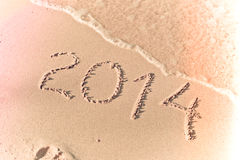 2014 new year message on the sand beach Stock Image