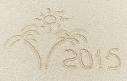 New year 2015 message on the sand beach Royalty Free Stock Images