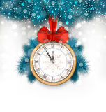 New Year Midnight Background with Clock and Fir Twigs Royalty Free Stock Image