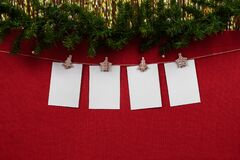 New year mock up with 4 blank white sheets for writing the number of the year or lettering on a red background with