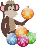 New year monkey. With balls on the Christmas tree Stock Photography