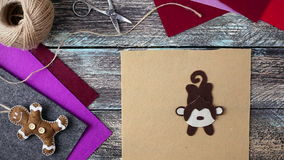 New Year monkey toy from felt symbol of 2016 stock footage