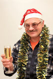 New-year mood. Man in the hubcap of Santa Klaus with glass of champagne Royalty Free Stock Images