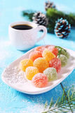 New Year mood: jelly candy and cup of coffee. Multicolored jelly candy, cup of coffee and New Year decoration Stock Photography