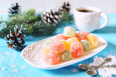 New Year mood: jelly candy and cup of coffee. Multicolored jelly candy, cup of coffee and New Year decoration Royalty Free Stock Images