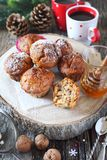 New Year mood: spiced honey muffins with walnuts, two cups of coffee. New Year pastry: spiced honey muffins with walnuts, two cups of coffee and pine cones Royalty Free Stock Photos